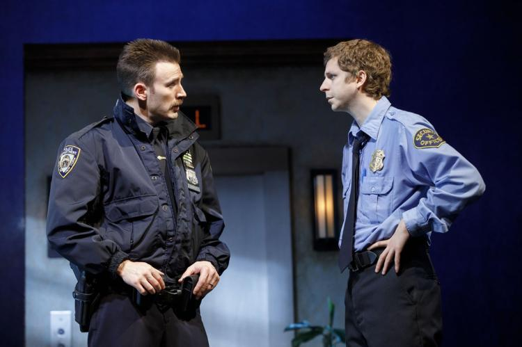 "Bill (Chris), one of New York's not-so-finest, and Jeff (Michael Cera), a high-rise security guard, don't see eye-to-eye in ""Lobby Hero."""