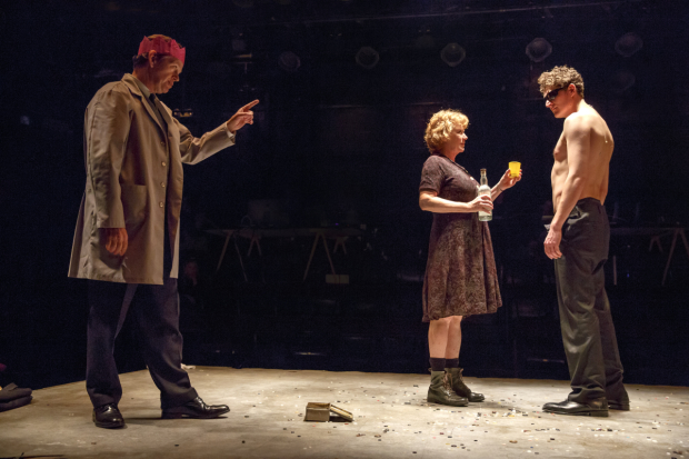 Dylan Baker, Becky Ann Baker, and Gabriel Ebert perform on a stage covered in buttons in Peer Gynt.